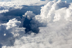 Puffy Clouds from Above. Puffy clouds seen from an airplane Royalty Free Stock Photo