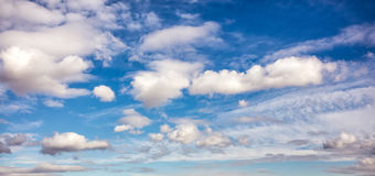 Puffy clouds on sky Stock Images