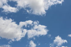 Puffy clouds, sunny day Royalty Free Stock Image