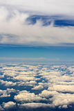 Puffy clouds - view from the plane's window stock photography