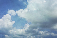 Puffy Clouds Vintage Textured Sky Stock Photo