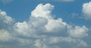 Puffy Clouds. White puffy  clouds in a blue sky Stock Photos