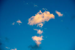 Puffy and colorful sunset clouds Stock Photo