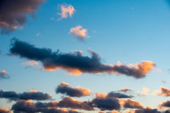 Puffy and colorful sunset clouds Royalty Free Stock Photos