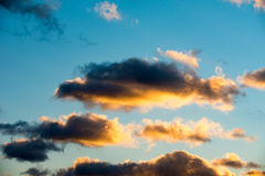 Puffy and colorful sunset clouds Stock Images