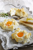 Puffy sunny-side up eggs Royalty Free Stock Photography