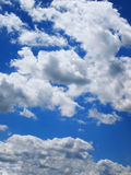 Puffy Thick Clouds Blue Sky Stock Image