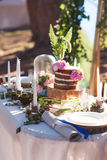 Puffy wedding cake with flowers. On decor table with candles Stock Image