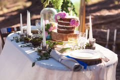 Puffy wedding cake with flowers. On decor table with candles Royalty Free Stock Images