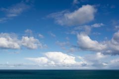 Clouds Against Blue Skies Above the Ocean Stock Image