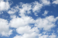 Puffy white clouds. In a blue sky royalty free stock photography