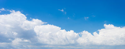 Puffy white clouds against blue sky background Stock Photography