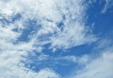 Puffy white clouds. In the blue sky for background Royalty Free Stock Photo