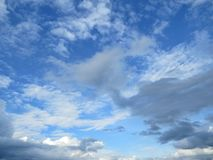 Puffy white clouds. In the blue sky for background Stock Photography