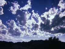 Puffy white clouds and blue sky royalty free stock photo