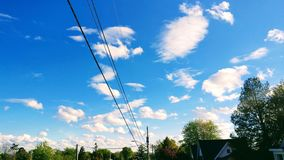 Puffy white clouds Stock Photos