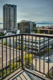 Puget Sound and Downtown Seattle from Balcony. The View from a Patio of a Downtown Seattle Condominium looks out across the Puget Sound and Olympic Mountains Royalty Free Stock Images