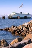 Puget Sound Ferry and Shoreline. View of Ferry Boat in the Puget Sound, Washington State, from rocky shoreline at Edmonds water front beach royalty free stock photography