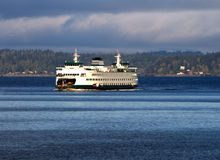 Puget Sound Ferry v1. Is one of the many Ferries in the state of Washington captured near Seattle. There is a cloudy sky which is common sight for the region royalty free stock images