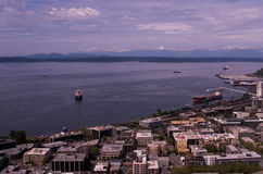 The Puget Sound with the Olympic Mountains. Cargo Ship heading towards Seattle with the Olympic Mountains in the distance Royalty Free Stock Images