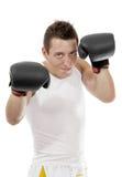 Pugile fiero con i guanti di inscatolamento dopo la lotta Immagini Stock
