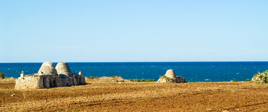 Puglia - South Italy Seascape. Pajaras - ancient buildings on seascape Royalty Free Stock Images