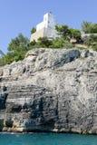 Pugno chiuso lighthouse on the coast of Gargano National park Stock Photo