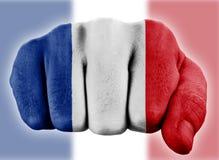 Pugno con la bandierina francese Immagini Stock Libere da Diritti