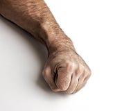 Pugno dell'uomo su un fondo bianco Immagini Stock