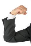 Pugno serrato, braccio in vestito di affari Immagine Stock