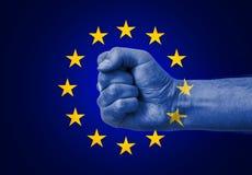 Pugno sopra la bandiera dell'UE Fotografia Stock Libera da Diritti