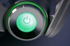 Puissance d'ordinateur verte sur le bouton rougeoyant Photographie stock