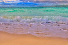 Puka Shell Beach. Has golden sand and picture was taken with canon Royalty Free Stock Photography