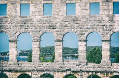 Pula Arena, Istria, Croatia, analog filter. Detail photo of Pula Arena, Istria, Croatia. Travel destination. Ancient architecture. Analog photo filter with stock photo