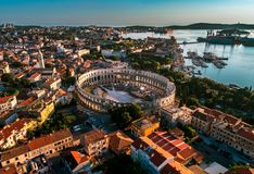 Pula Arena at sunset - aerial view taken by a professional drone. Pula Arena at sunset - HDR aerial view taken by a professional drone. The Roman Amphitheater of royalty free stock photos