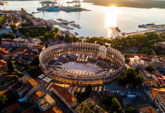 Pula Arena at sunset - The Roman Amphitheater of Pula, Croatia. Pula Arena at sunset - HDR aerial view taken by a professional drone. The Roman Amphitheater of royalty free stock images