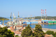 Pula Comersial Docks. Pula, Croatia - September 12, 2015: Seen from the old castle of Pula - The port of Pula with cranes, industrial docks and warehouses in the Stock Photo