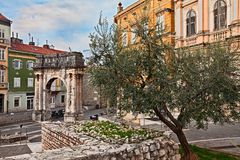 Pula, Istria, Croatia: the ancient Roman Triumphal Arch of the S. Ergii, one of the old city gate stock image