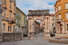 Pula, Istria, Croatia: the ancient Roman Triumphal Arch of the Sergii. One of the old city gate stock photos