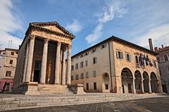 Pula, Istria, Croatia: the Roman Temple of Augustus. Pula, Istria, Croatia: the ancient Roman Temple of Augustus and the town hall in the downtown of the city stock image