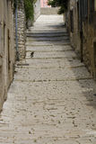 Pula narrow stone street. Narrow medieval street in Croatian town Royalty Free Stock Photos