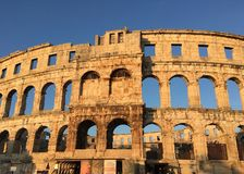 Pula`s Arena in Croatia at sunset royalty free stock image