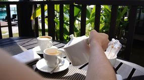 PULAU LANGKAWI, MALAYSIA - APR 5th 2015: English Tea time Party with sandwiches, woman pouring tea.  Stock Photo