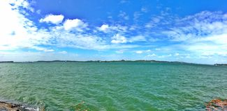 Pulau Ubin seen from Pasir Ris beach in Singapore Royalty Free Stock Images