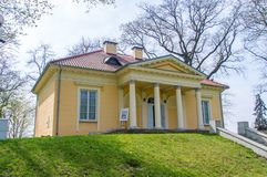 Yellow Alexandria Cottage in park of Czartoryski Palace in Pulawy, Poland. royalty free stock photography