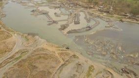 Pulendo ed approfondire dal onriver della draga Java, Indonesia immagine stock