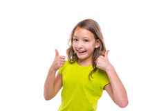 Pulgar aceptable del gesto encima de la muchacha feliz del niño del yute en blanco Imagen de archivo