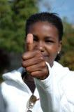 Pulgar africano para arriba Foto de archivo libre de regalías