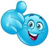 Pulgar azul encima del emoticon Fotos de archivo