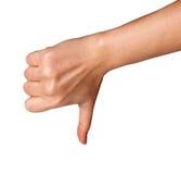 Pulgar de la mano de la mujer abajo aislado en el fondo blanco Símbolo del rechazo Imagenes de archivo